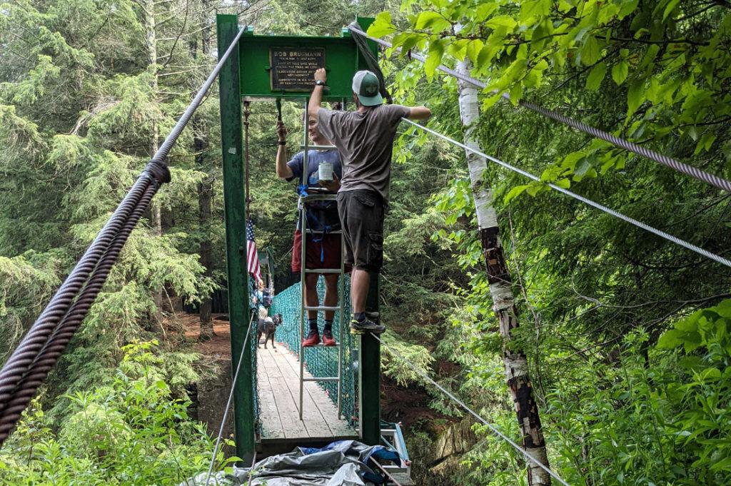 Staff repair Clarendon Gorge Bridge.